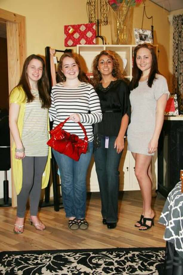 Submitted Photo Left to right, Nora Jefferies (Hamden), Liza Gillooly (North Haven), Amanda Maturo (Hamden), and Emma Dwyer (North Haven) are all set for the Annual Sacred Heart Academy Fashion Show to be held at Anthony's Ocean View on New Haven Harbor on April 27.