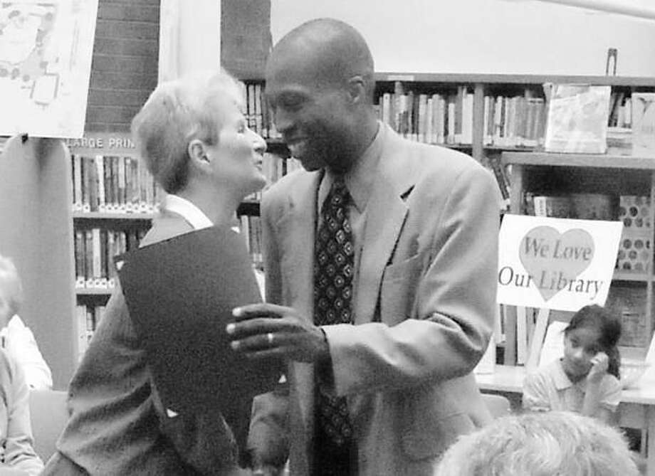 Submitted Photo Hamden Mayor Scott B. Jackson congratulates Carol Mitchell, Hamden Public Library's Volunteer of the Year at a reception recently held at the library.