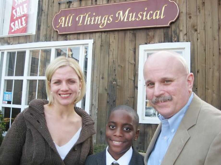 Submitted Photo Scholarship sponsor Allison Tirozzi shares a moment with scholarship recipient Dominique Green and George Raccio outside of Raccio's studio, All Things Musical.