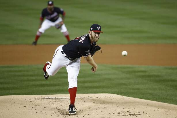 Washington Nationals starting pitcher Stephen Strasburg throws during the first inning of Game 3 of the baseball National League Championship Series against the St. Louis Cardinals Monday, Oct. 14, 2019, in Washington. (AP Photo/Patrick Semansky)