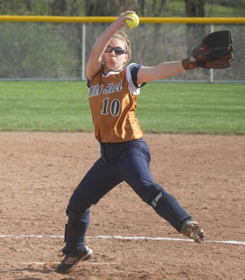 Lyman Hall junior pitcher Lauren Zambrano fires a pitch in a recent game. Zambrano pitched the second perfect game of her career while leading the Trojans to a 6-0 victory over Sacred Heart Academy last week. (Photo by Russ McCreven)
