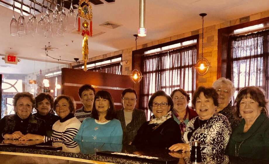 From left, Woman's Club members Marge Giunti, Rosalind Nevola, Annette LaVelle, Pat Trenchard, Frankie GibiserLinda Bishop, Carol DellaPietra, Bonnie Fahy, Annemarie McConville, Judy Feather, and Debbie Boyaji.