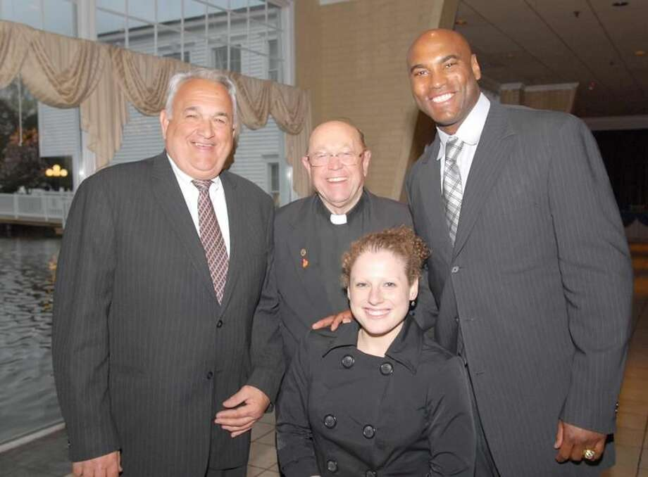 Pictured, from left to right, are Hamden resident Tom Marcucci, coach at Notre Dame (Male Coach of the Year), Rev. Owen Sanderson of Christ Church in Hamden (Good Sport Award), Hamden native Scott Burrell, (Gold Key recipient) and Deb Gruen a Hamden Hall grad now at Yale, who has spina bifida and is a world record paralympic swimmer, winner of the Bob Casey Courage Award. (Photo by Bill O'Brien)