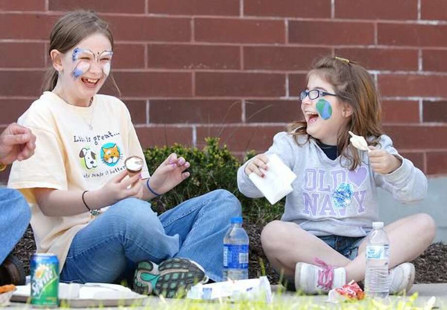 Photos by Peter Casolino 10-Year-old Carissa Poole, left, and 8-year-old Olivia Broderick, both of Hamden, share a laugh over some ice cream during the 2010 Hamden Earth Day celebration. For more photos from Saturday's event, visit www.ctpostchronicle.com.