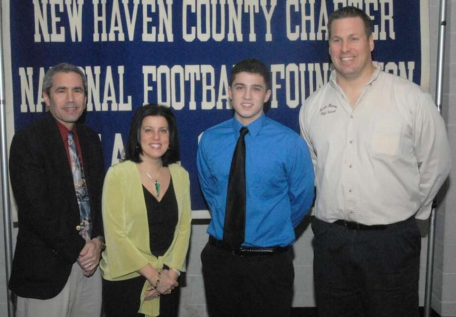 North Haven scholar athlete Matthew Vece stands with parents Blaise and Diane and coach Anthony Sagnella. Vece will represent this year's scholar athletes as speaker at the 50th Anniversary Dinner. (Photo by Bill O'Brien)