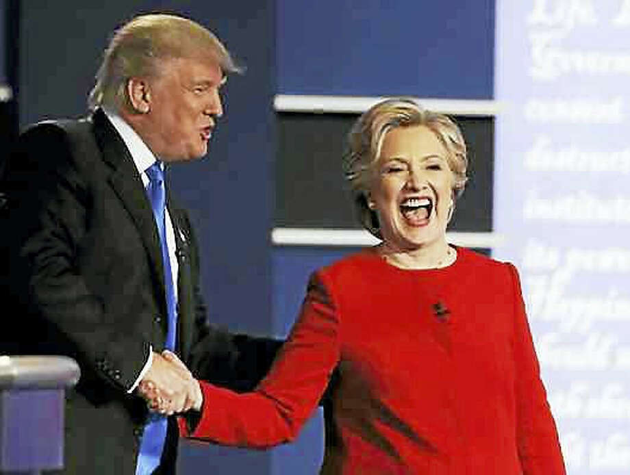 Julio Cortez — THE ASSOCIATED PRESS Democratic presidential nominee Hillary Clinton laughs with Republican presidential nominee Donald Trump following their presidential debate at Hofstra University in Hempstead, N.Y., Sept. 26.