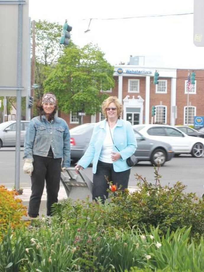 """Submitted Photo by Diane Hoffman Lyn Baumgartner, left, and Mary DeSarbo are the recipients of the Hamden Clean and Green Commission Civic Orchid Award for the """"Karma Garden"""" located in the traffic island at the intersection of Putnam and Dixwell Avenue."""