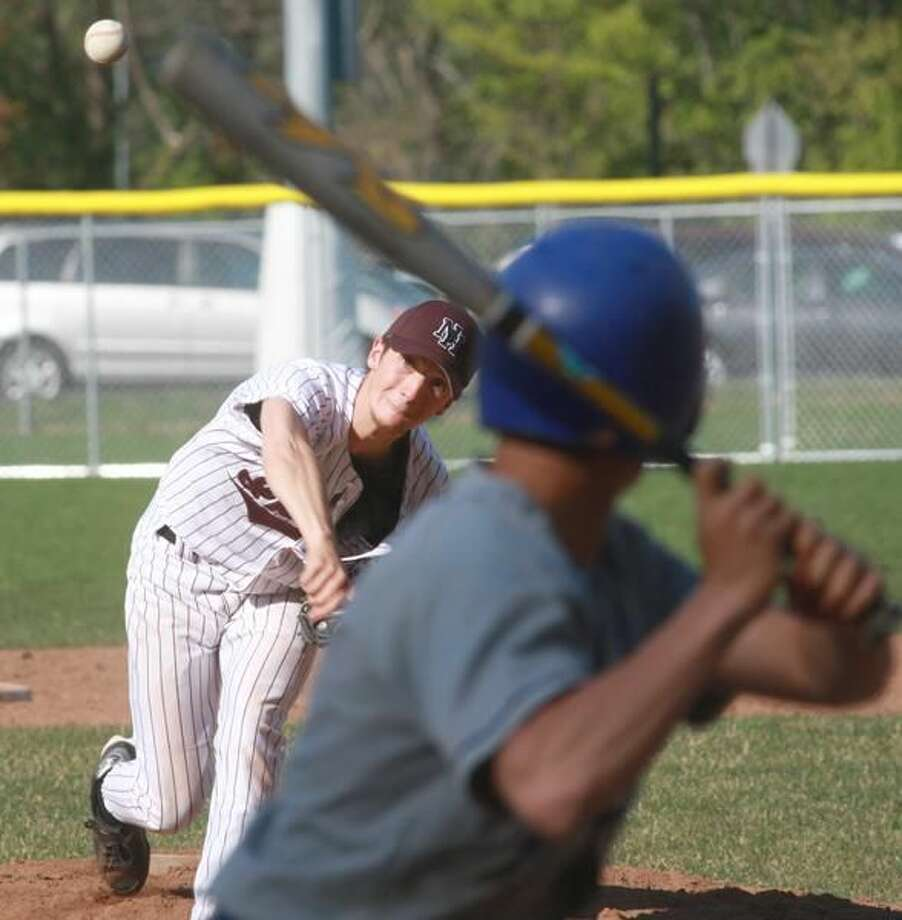 North Haven's Steve Cusano fires a pitch against West Haven last Friday afternoon. Cusano pitched the Indians to a 3-1 victory and improved his record to 1-2. (Photo by Russ McCreven)