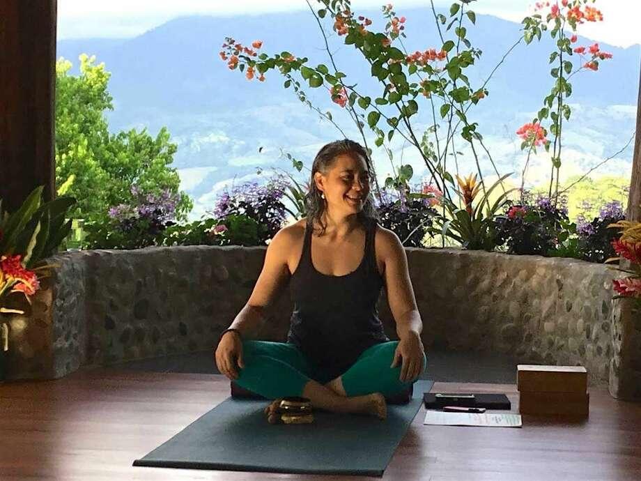 Julie Bailis practices yoga