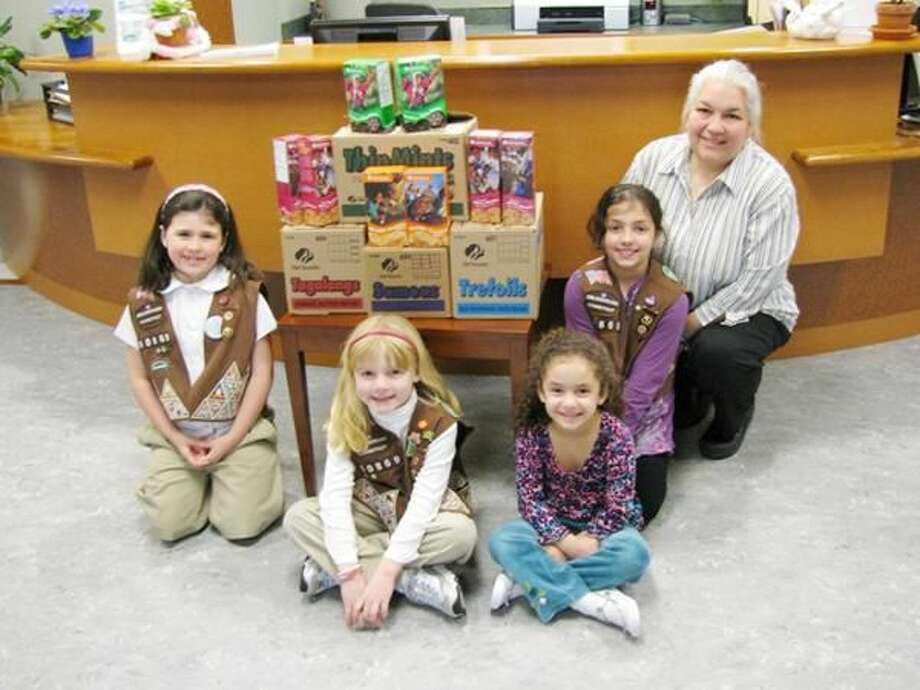Submitted Photo Pictured from left are Hamden Brownie Troup No. 60869 members Morgan Dubay, Samantha Gilbert, Olivia Sangiovanni and Alexis Sangiovanni with Angela Halloran-Venegas, administrative supervisor at the center.