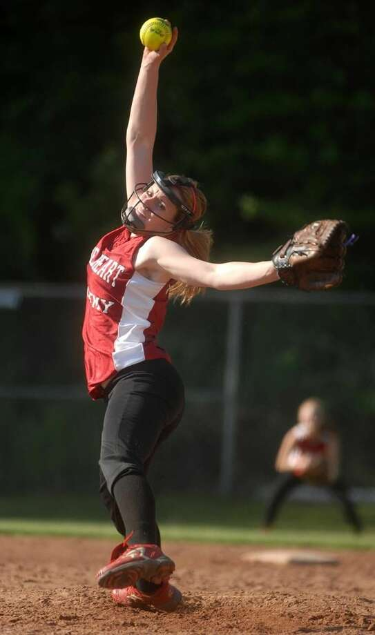Sacred Heart's Gina Valentine delivers a pitch in the Pacers' thrilling 9-3 comeback victory over town rival Hamden on Wednesday. (Photo by Brad Horrigan/ New Haven Register)