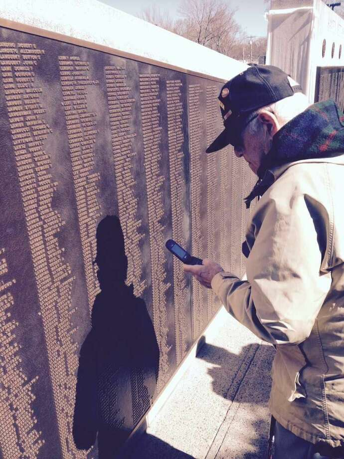 Veteran Marvin Cohen studies the names at the Hamden Veterans Memorial.