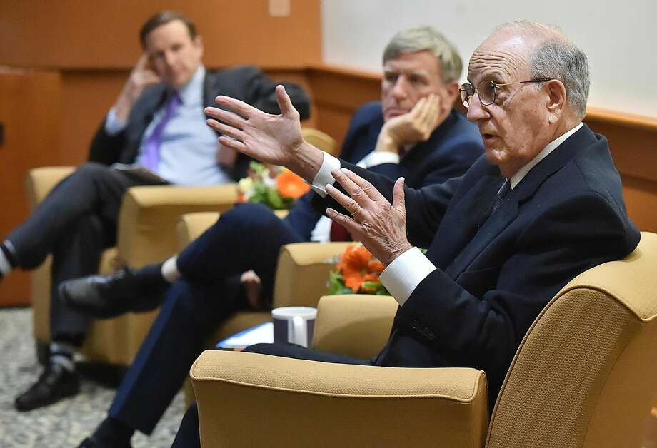 George Mitchell, former United States Special Envoy for Northern Ireland, right, discusses the state of Northern Ireland's peace on the 20th anniversary of the Good Friday Agreement with Daniel Mulhall, Ireland's Ambassador to the U.S, hosted by Sen. Chris Murphy at the Frank H. Netter MD School of Medicine at Quinnipiac University in North Haven.