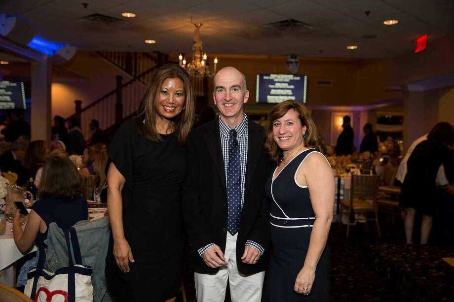 At the helm ... Honorary Chair Jocelyn Maminta with Auction Chairs Steve and Jackie Fitzgerald.