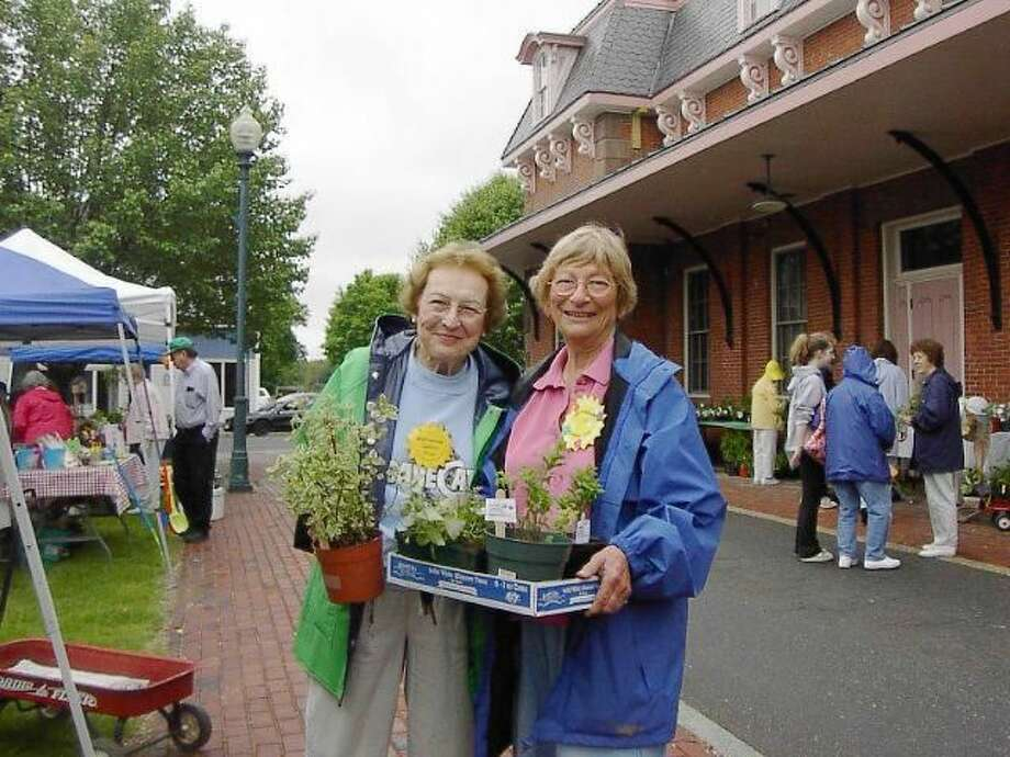 Submitted Photo Wallingford Garden Club members Shirley Rouse and Henni Stolzman are pictured at the club's annual plant sale, Saturday, May 8, at the Railroad Station Green.