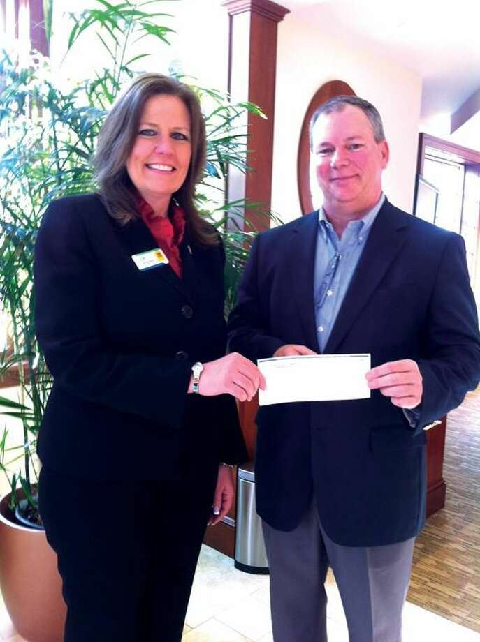 Submitted Photo Delivering the gift to Donate Life's Paul Murray, right, is Hamden Rotarian Lisa Brewster.