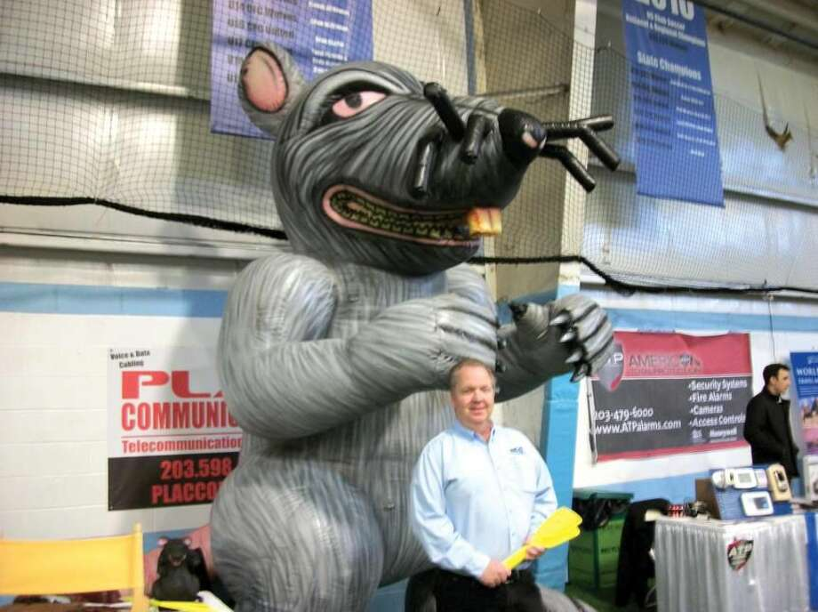 Photo by Lynn Fredricksen Bob Hannon, shown here with his oversized inflatable rodent, enjoyed some foot traffic at last week's Business and Community Expo. Presented each year by the Hamden Regional Chamber of Commerce, the event brings members of the community and business professionals together to promote local businesses.