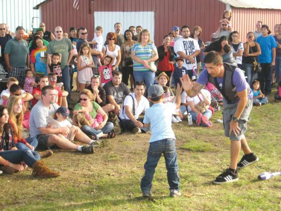 Submitted Photo 2012 North Haven Fair goers enjoy one of many entertainers that perform each year.