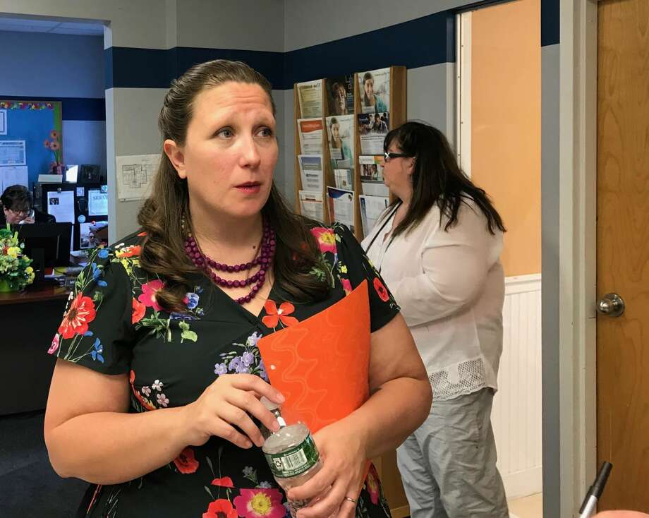 Sarah Selvaggi-Hernandez of Enfield, speaks to reporters after meeting with students at High Road Academy in Wallingford.