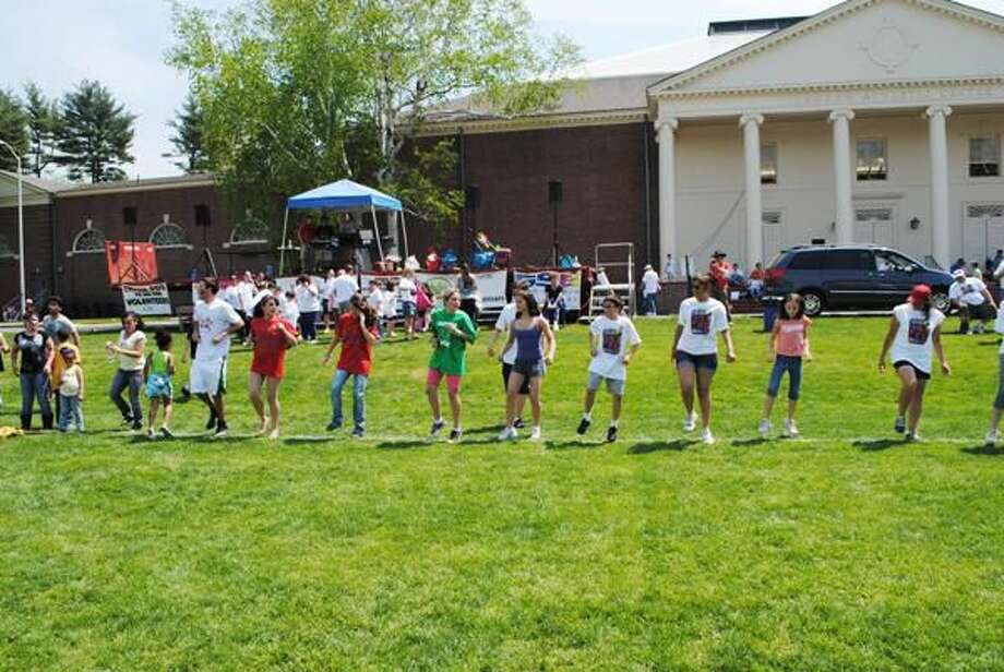 Submitted Photo A group of kids dance to the music provided by Johnny Roz, of Sound Spectrum, who volunteered his time for the annual Walk/Run for Autism on the campus of Choate Rosemary Hall, Sunday, May 2.
