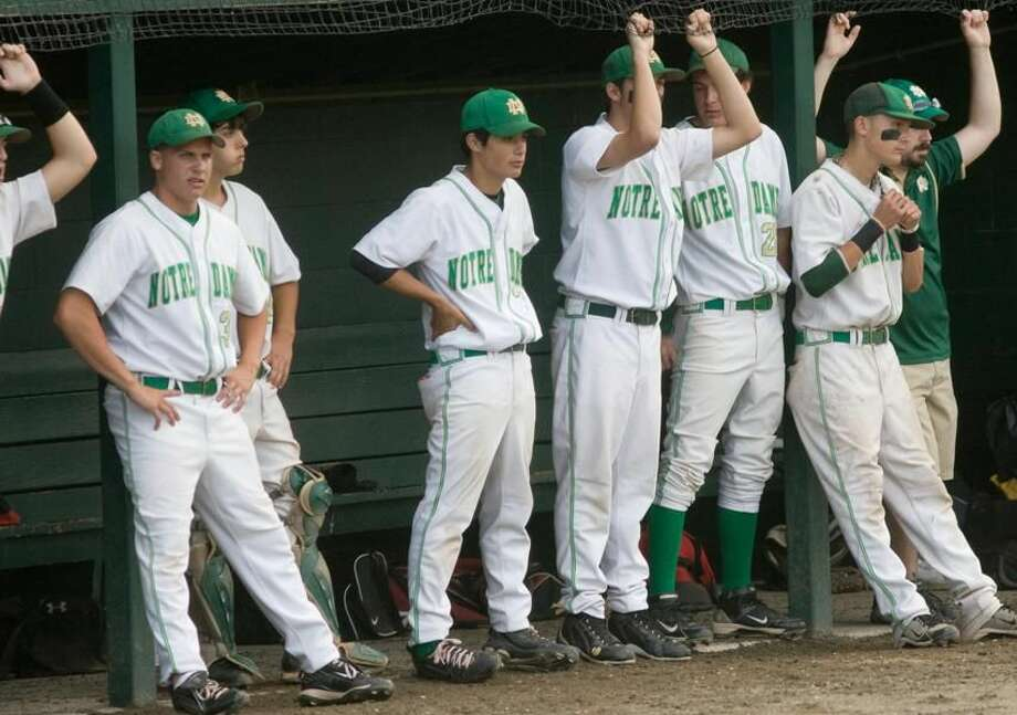 The Notre Dame-West Haven bench looks on late in the Green Knights' 9-4 loss to Sheehan in the Class L championship final at Palmer Field in Middletown. (Photo by John Steady)