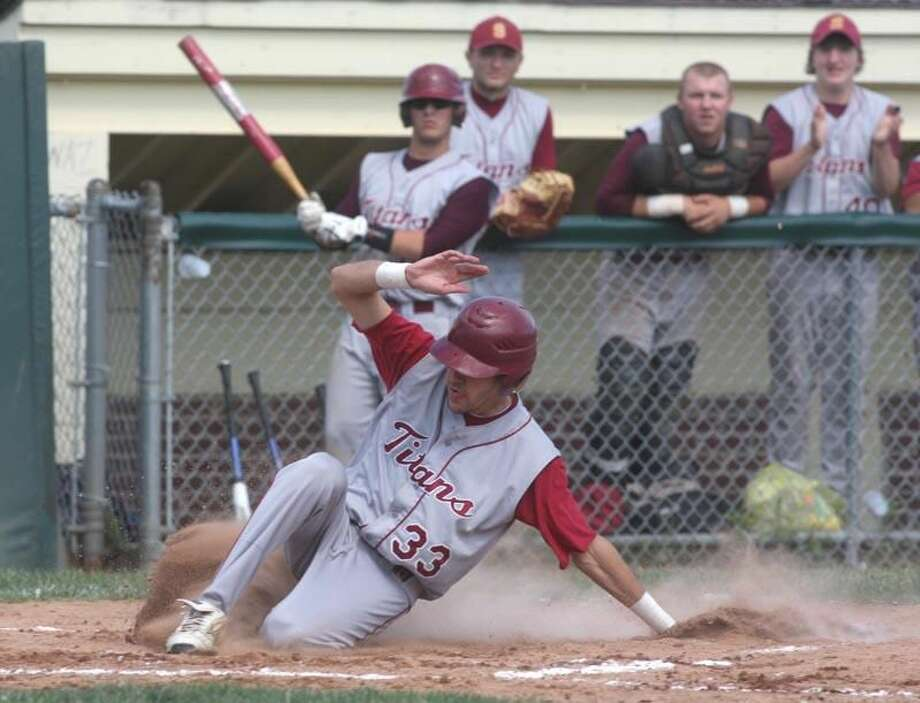 Sheehan's Kyle Van Hennick slides safely into home during the Titans' 7-5 victory over Law in the Class L quarterfinals. Sheehan advanced to Friday's championship game with a 4-3 victory over North Haven on Tuesday night. (Photo by Russ McCreven)