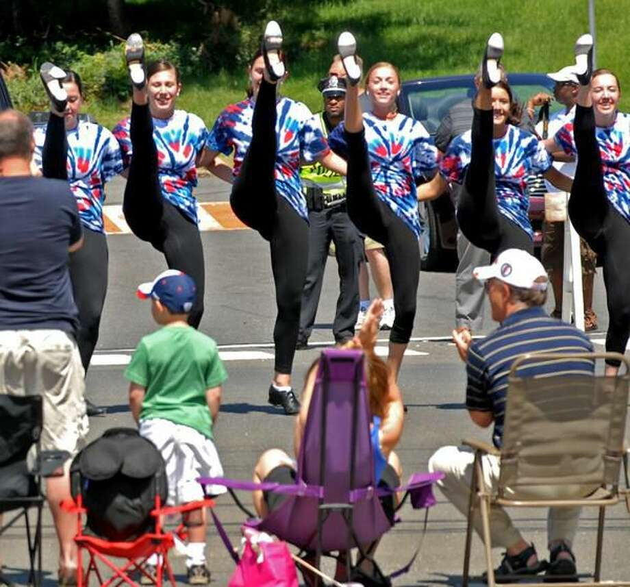 Photo by Peter Hvizdak Tap Dancers from the American Dance Experience dance studio of Hamden perform on Dixwell Ave. Monday during Hamden's 74th annual Memorial Day Parade.
