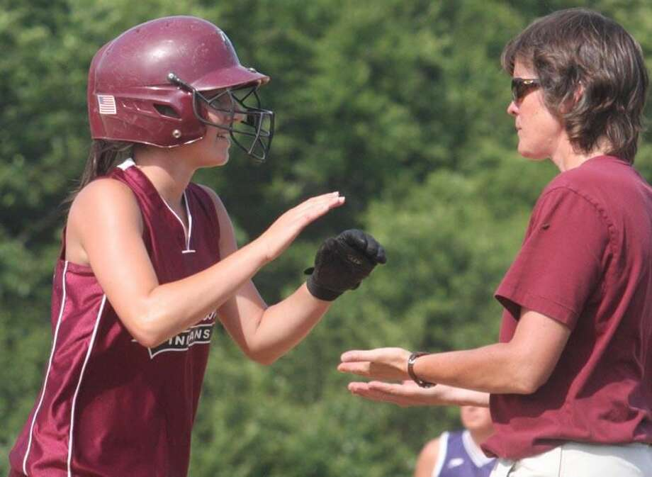 North Haven softball coach Sally Maher congratulates a player in the Indians' 5-4 loss to East Haven in the Class L state tournament. (Photo by Russ McCreven)