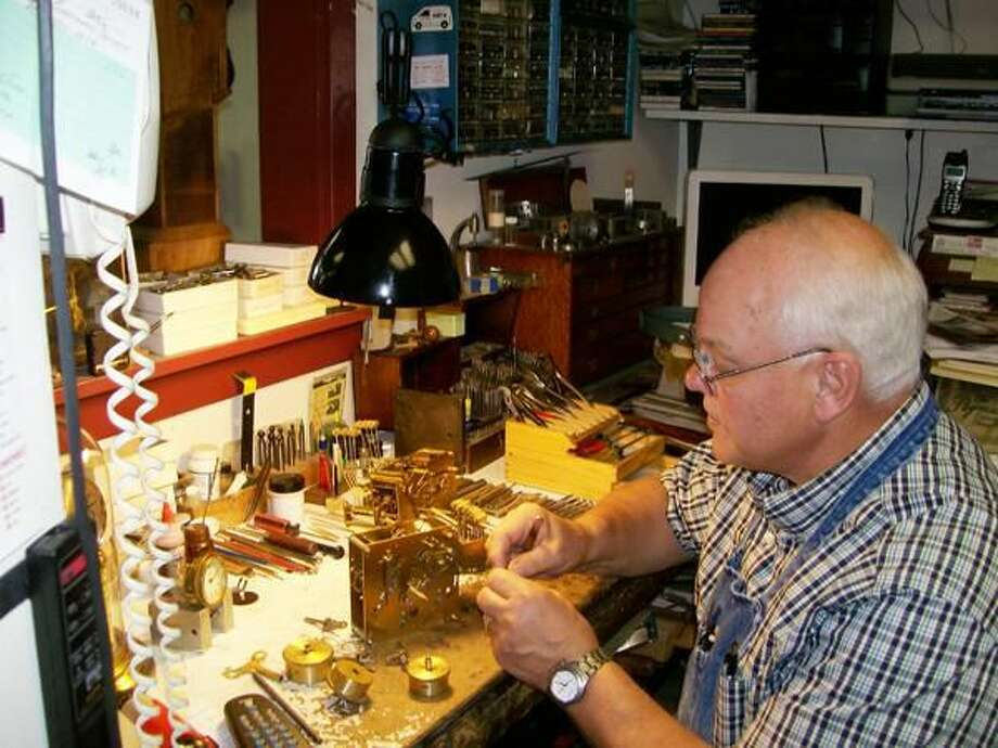 Photo by Lynn Fredricksen Certified Master Clockmaker Raymond Pavkov works on the intricate pieces of a customer's grandfather clock. Pavkov owns Yankee Clock Peddler at 2003 Whitney Ave. in North Haven.