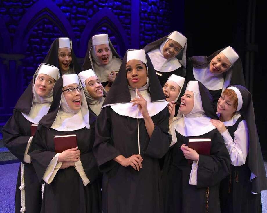 "Zuri Washington, center, as Deloris Van Cartier and The Sisters in ""Sister Act."""