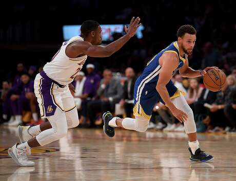 LOS ANGELES, CALIFORNIA - OCTOBER 14:  Stephen Curry #30 of the Golden State Warriors drives to the basket on Demetrius Jackson #20 of the Los Angeles Lakers during the first half at Staples Center on October 14, 2019 in Los Angeles, California. (Photo by Harry How/Getty Images)
