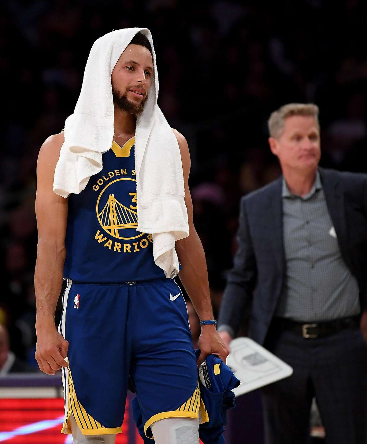 Stephen Curry #30 of the Golden State Warriors and head coach Steve Kerr react after a timeout during the first half against the Los Angeles Lakers at Staples Center on October 14, 2019 in Los Angeles, California. (Photo by Harry How/Getty Images)
