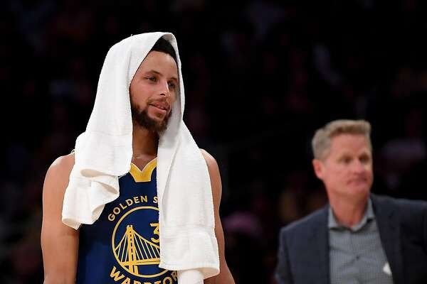 LOS ANGELES, CALIFORNIA - OCTOBER 14: Stephen Curry #30 of the Golden State Warriors and head coach Steve Kerr react after a timeout during the first half against the Los Angeles Lakers at Staples Center on October 14, 2019 in Los Angeles, California. (Photo by Harry How/Getty Images)