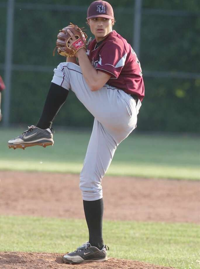 North Haven pitcher Chris Lavorgna winds up in a recent game against Notre Dame-West Haven. The Indians hosted Avon in the first round of the Class L state tournament Tuesday, after press time. (Photo by Russ McCreven)