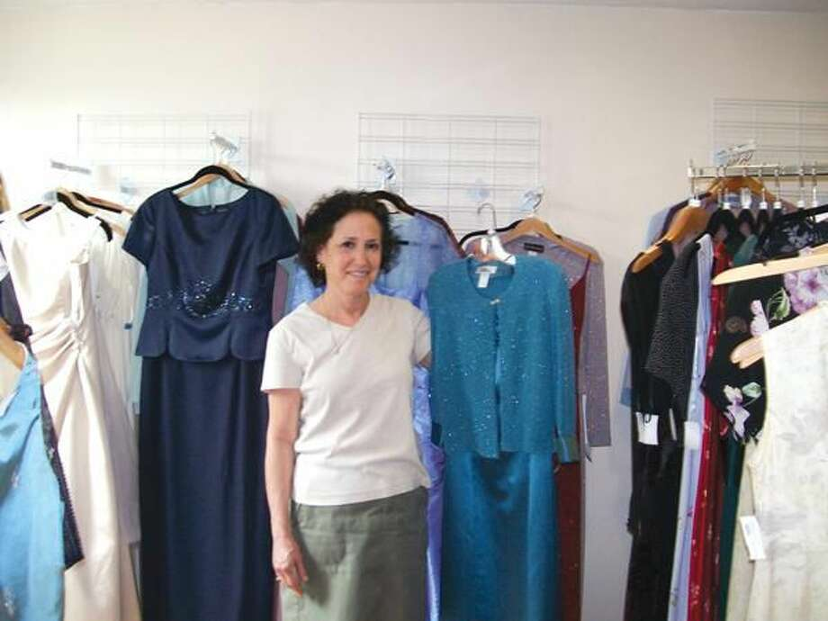 Photo by Lynn Fredricksen Laurie Rosenbaum shows off just one of the dresses at her boutique So Many Dresses at 2546 State St. in Hamden.