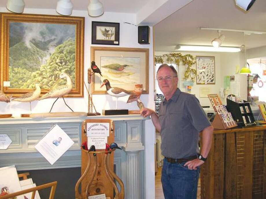 Photo by Lynn Fredricksen Jerry Connolly stands near one of his displays at his store, the Audubon Shop at 907 Boston Post Road in Madison.