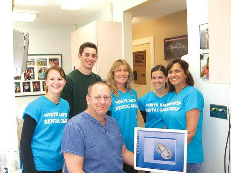 Photo by Lynn Fredricksen Dr. Stuart Lazaroff (center) is surrounded by his staff. From left to right: Christina Young, son Jeffrey Lazaroff, Jeanine Guerreri, Kristen Springer and Angela Springer. Missing from photo is Lazaroff's daughter, Risa Lazaroff.