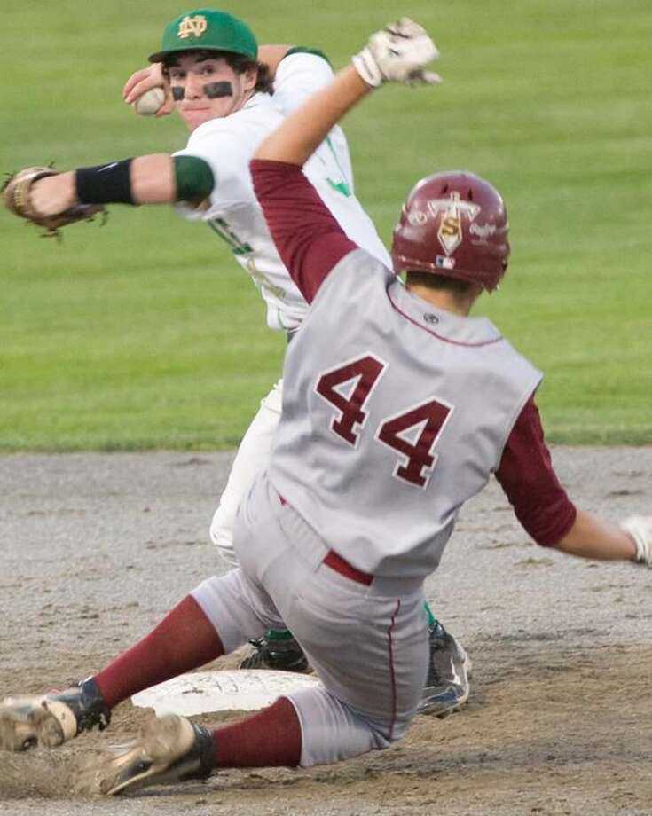 Notre Dame's Mike Panza forces out Sheehan's Reid Nelson and fires a throw to first. (Photo by John Steady)