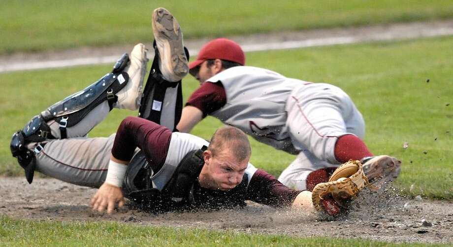 Sheehan catcher Tim Bickford makes a diving catch to retire the side during the fourth inning of the Class L final at Palmer Field in Middletown. (Photo by Peter Casolino/ New Haven Register)