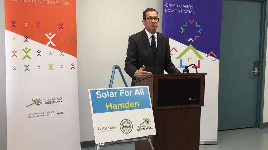 """Officials kicked off the """"Solar For All"""" initiative at the Keefe Community Center in Hamden. Above, Gov. Dannel P. Malloy speaks."""