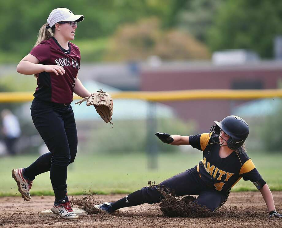North Haven shortstop Caitlin Ranciato looks for the throw as Amity's Rachael Crow steals second base on Thursday.