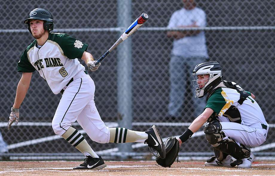 Notre Dame-West Haven's John Martinello collects a hit against Hamden on Friday.