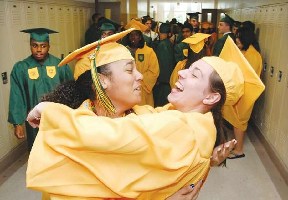 Photo by Peter Casolino Hamden High graduates prepare for their commencement ceremony in Hamden High School, Thursday, June 17.