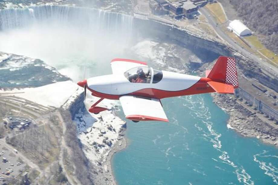 Submitted Photo Gayle Schutte (at the helm) and her niece Christa Nelson fly over Niagara Falls earlier this year.