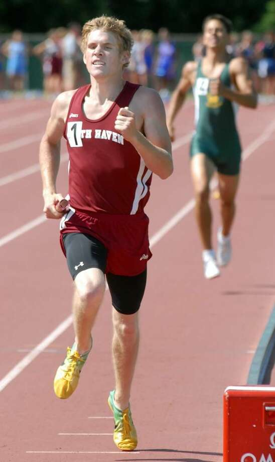 North Haven's J.P. Harris, left, ran the last leg of North Haven's victorious 4x800 relay team at the Class L championships. (Photo by Mara Lavitt/ New Haven Register)