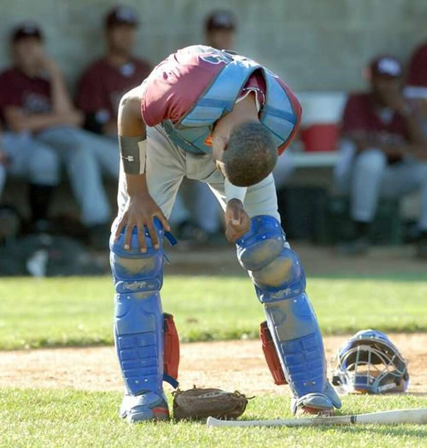 North Haven's Shaddiem Parilla experiences some pain after being struck by a foul ball in Post 76's 1-0 loss to East Haven last week. It was the second time Parilla was hit by the ball in a matter of minutes. Earlier he was hit by a pitch as a batter. (Photo by Mara Lavitt/ New Haven Register)