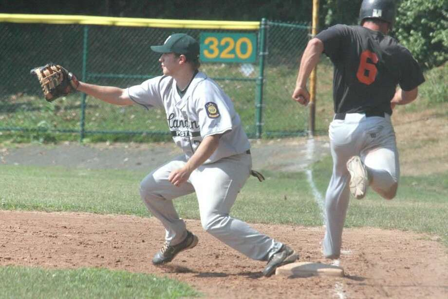Photo by Russ McCreven Hamden first baseman Matt Elia reaches for the ball as Shelton's Nick Salleme steps on the bag in last week's game. Hamden finished the season 11-13 and failed to qualify for the state play-in tournament.