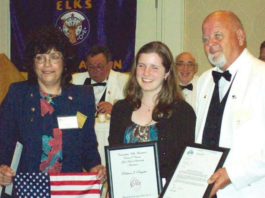 Submitted Photo Left to right: Karen Forsyth, Hamden Elks 1st Vice President and CT Elks Association Scouting Coordinator; Rebecca Paquette, Robert T. Curran Girl Scout Scholarship recipient; Dan Skiba; President of the CT Elks Association.