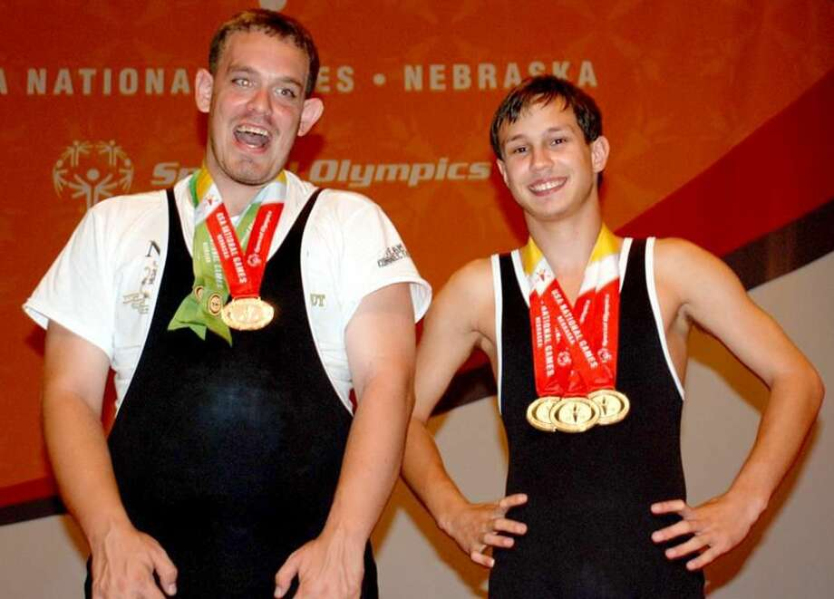 Submitted photo Wallingford's Mike Canty Jr. (left) celebrates his Silver Medal victory along with James DePaola of Meriden at the Special Olympics USA National Games last week in Lincoln, Neb.