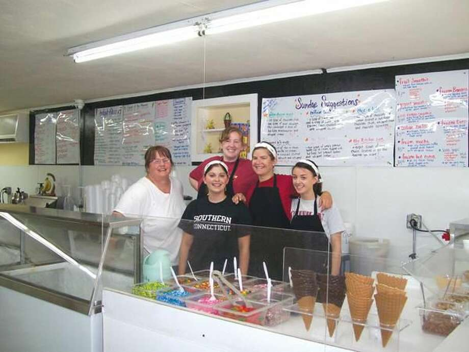 Photo by Lynn Fredricksen Wentworth's owner Regina Banos, left, and her crew, left to right, Vicki Pirozzoli, Michele Montano, Amber Durant and Lauren Fraulo are ready for the next onslaught of customers looking to beat the heat. Wentworth's has two locations: 3697 Whitney Ave. in Hamden and 44 Center St. in Wallingford.
